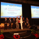 Dr Julian Ng receiving a certificate on behalf of WC