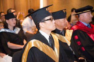 Graduates sit expectantly