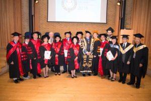 Doctoral graduates pose together