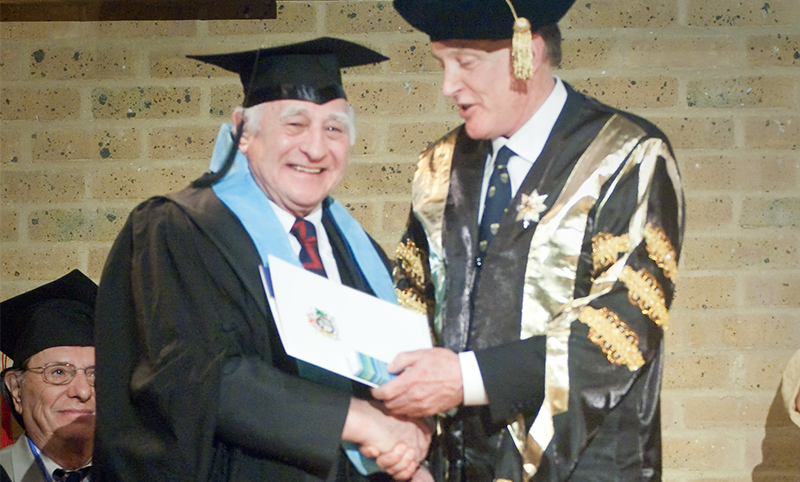 Dr Raymond Morland receives an award for outstanding service from Dr Brenden Tempest-Mogg