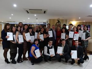 Teacher trainees celebrate after completing their course